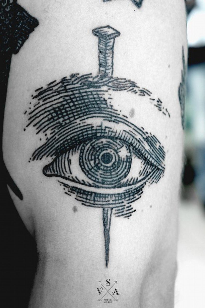 Awesome painted little black ink eye with nail tattoo on arm