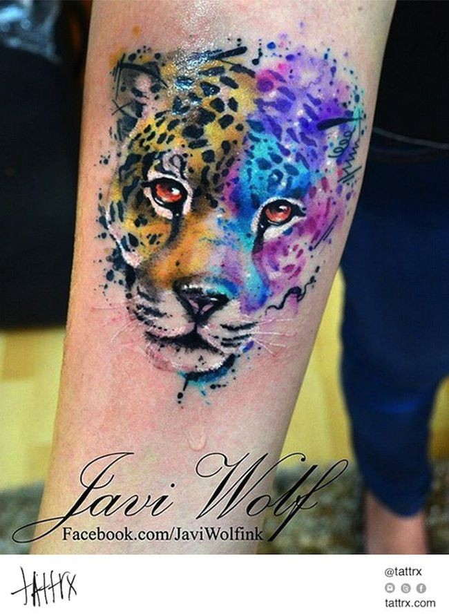 Awesome panther portrait colored tattoo on forearm by Javi Wolf in watercolor style