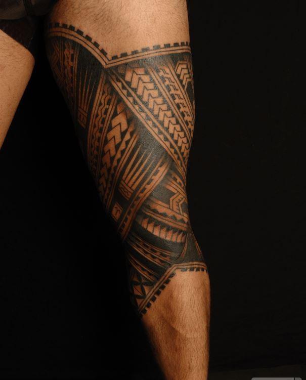 Awesome polynesian tattoo on leg