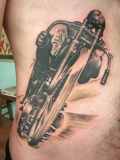 Awesome racer on a motorcycle tattoo on ribs