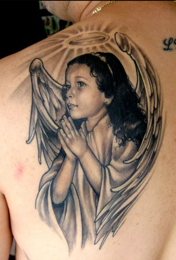 Awesome realistic cherub girl with nimbus tattoo on shoulder blade
