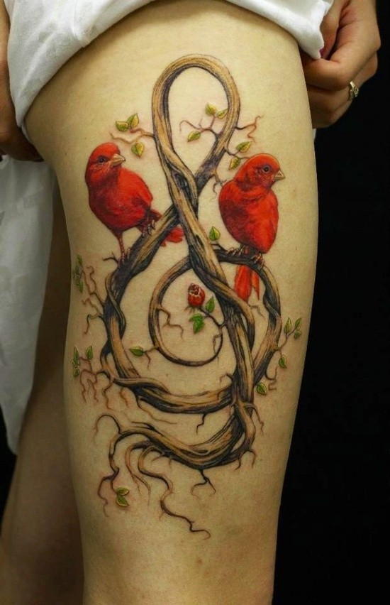 Awesome red birds and treble clef tattoo on thigh