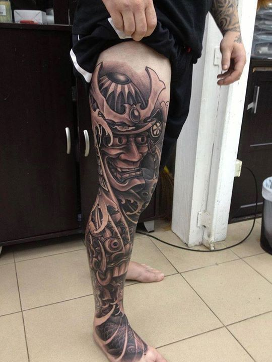 Awesome samurai in mask tattoo on leg
