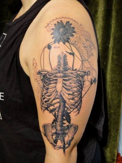 Awesome scientific style black ink human bones tattoo on shoulder combiend with ornamental flowers and numbers