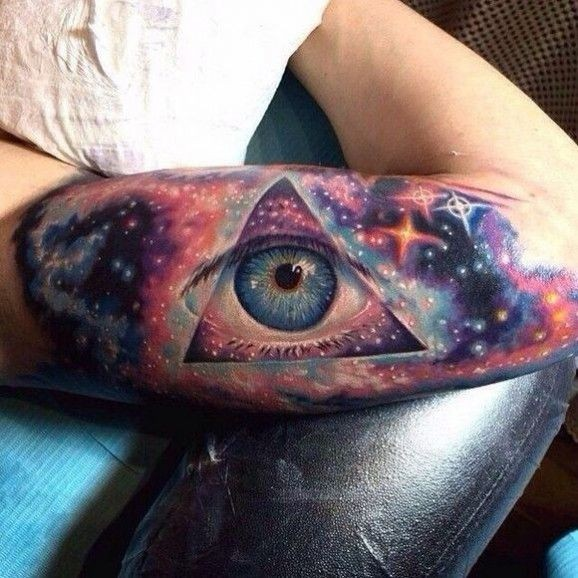 Awesome seeing eye of world with space tattoo on arm