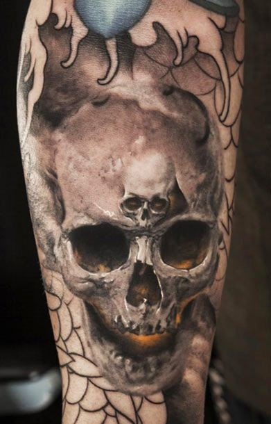 Awesome skull in skull tattoo