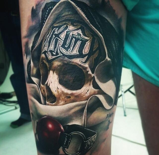 Awesome skull with black signs on forehead tattoo by Benjamin Laukis