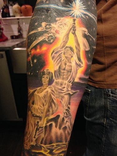 Awesome Star Wars themed colorful forearm tattoo with various heroes and space ship