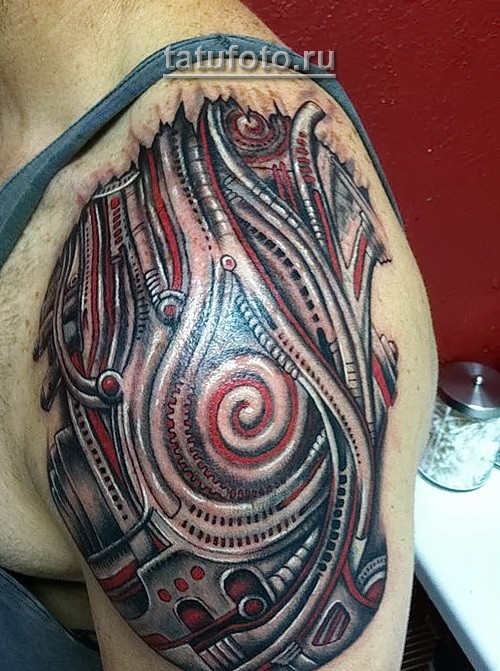 Awesome style colorful upper arm tattoo of alien mechanical technology