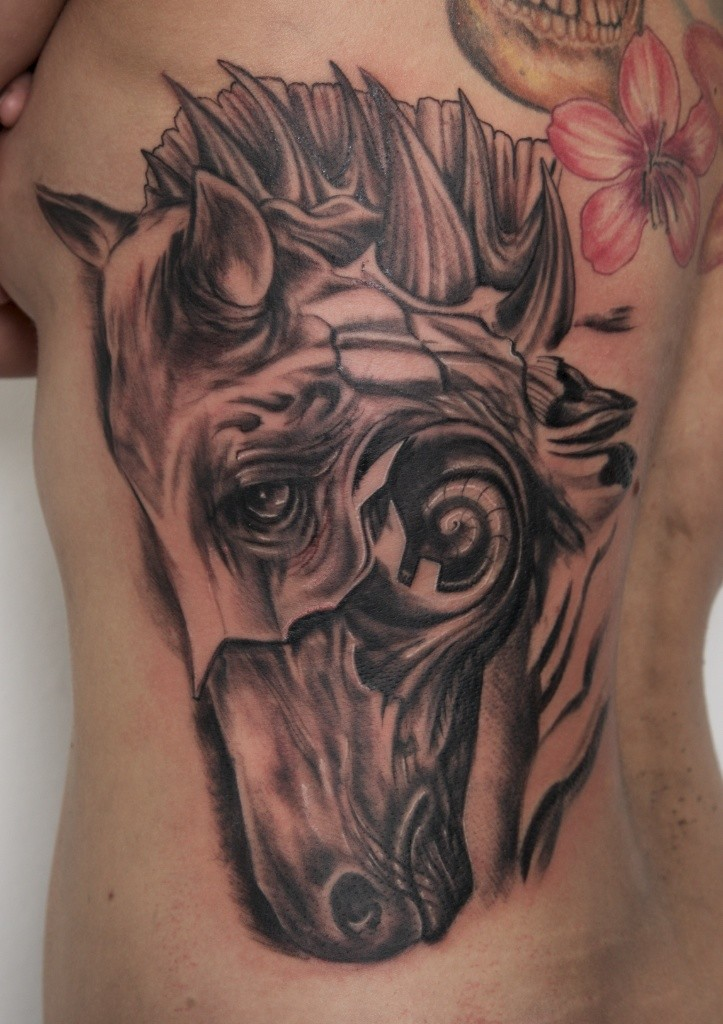 Awesome surreal dark horse head tattoo by graynd
