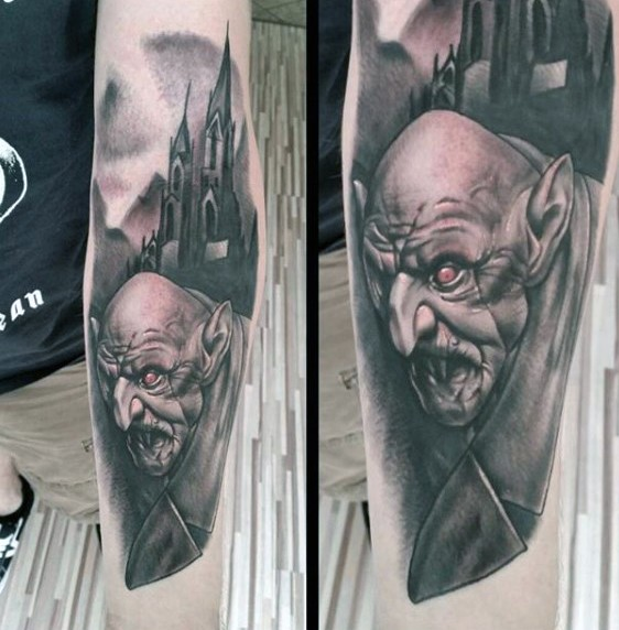 Awesome very detailed and colored night city monster tattoo on arm