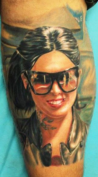 Awesome very detailed beautiful woman portrait tattoo on leg