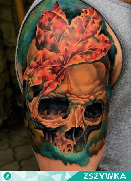 Awesome very detailed colorful skull tattoo on shoulder with maple leaf