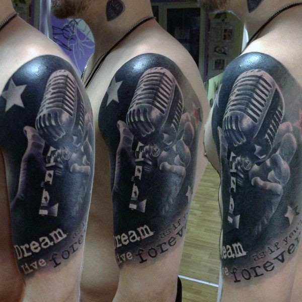 Awesome very realistic lack and white vintage microphone with lettering shoulder tattoo