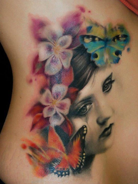 Awesome vintage photo like colored flowers with portrait tattoo on side
