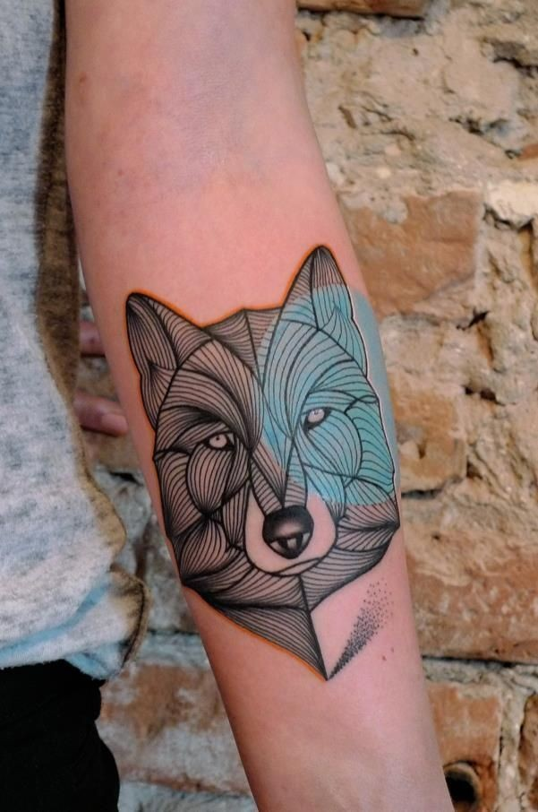 Awesome wolf head forearm tattoo