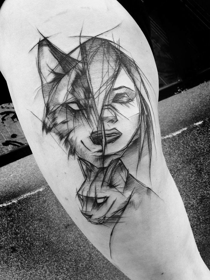 Awesome woman portrait tattoo combined with wolf and cat