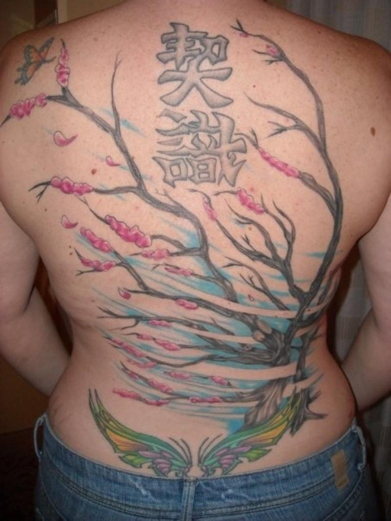Back tattoo with chinese tree and symbols