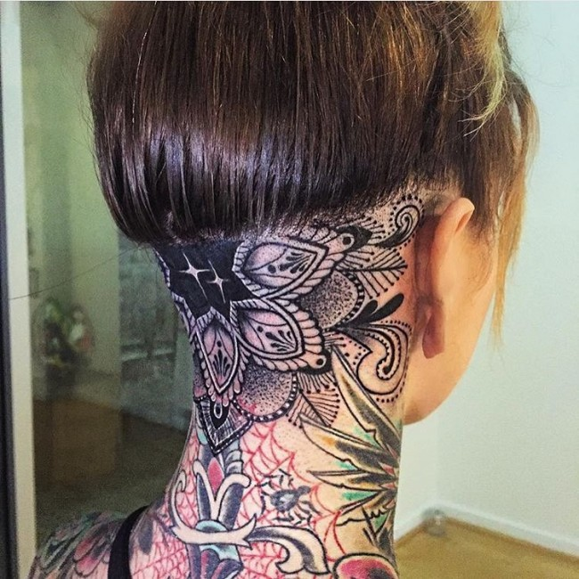 Baroque style black ink flower tattoo on neck