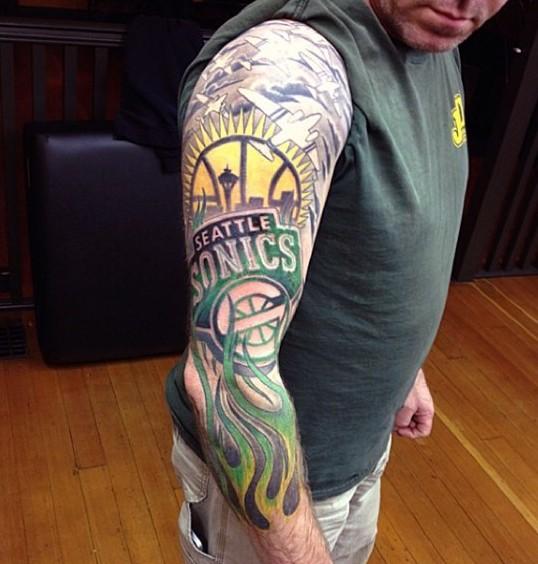 Basketball themed colored team emblem tattoo on sleeve