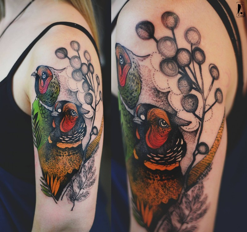 Beautiful accurate painted by Joanna Swirska upper arm tattoo of birds with flowers
