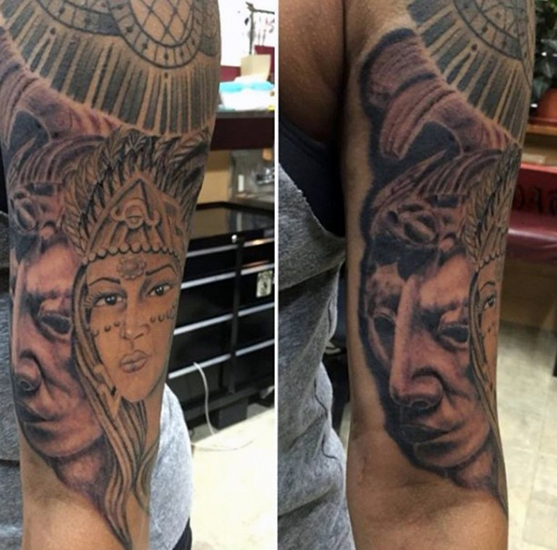 Beautiful accurate painted shoulder tattoo of tribal people portraits and statues