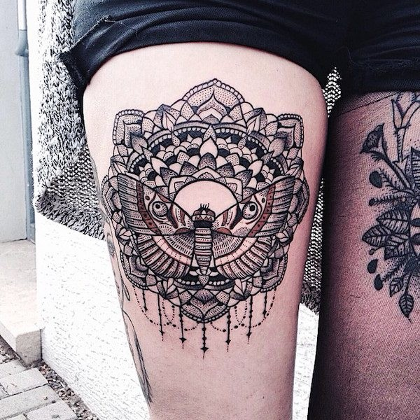 Beautiful Baroque style black and white flower tattoo on thigh combined with night butterfly
