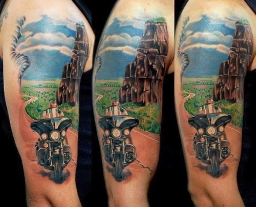 Beautiful biker and landscape tattoo on half sleeve