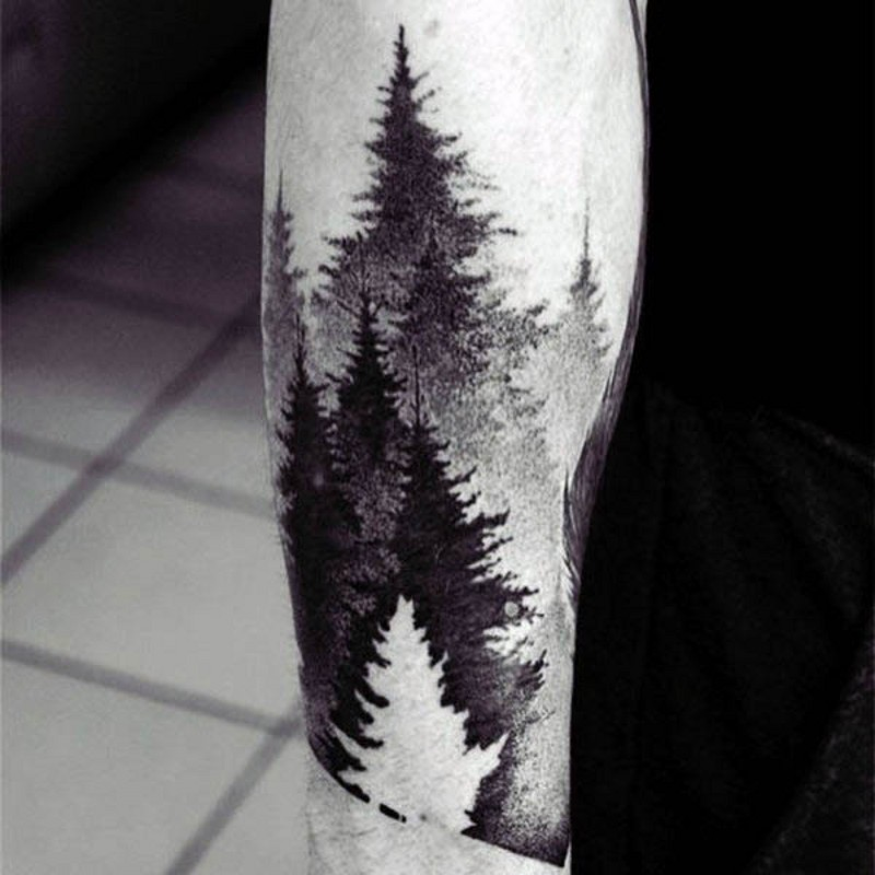 Beautiful black and white old forest tattoo on arm