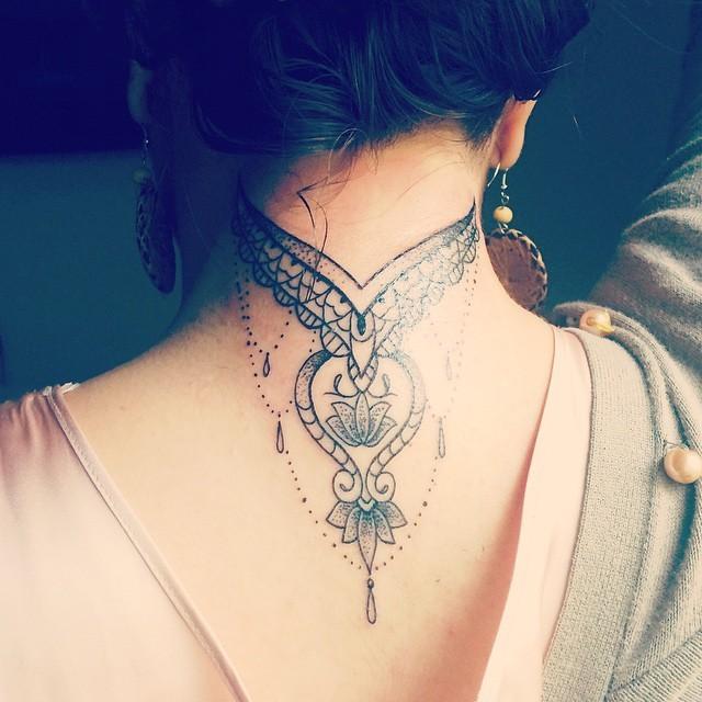 Beautiful black ink Baroque style neck tattoo of pendant