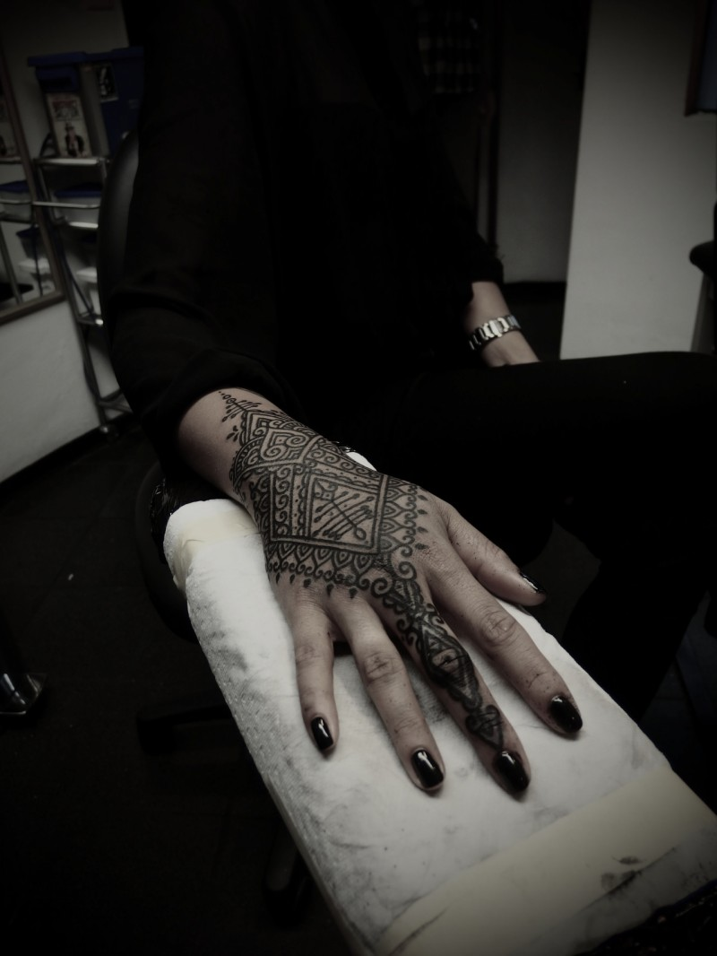 Beautiful black ink Hinduism style henna tattoo on arm
