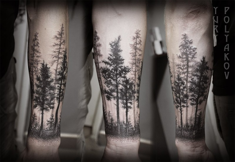 Beautiful black ink trees tattoo on forearm