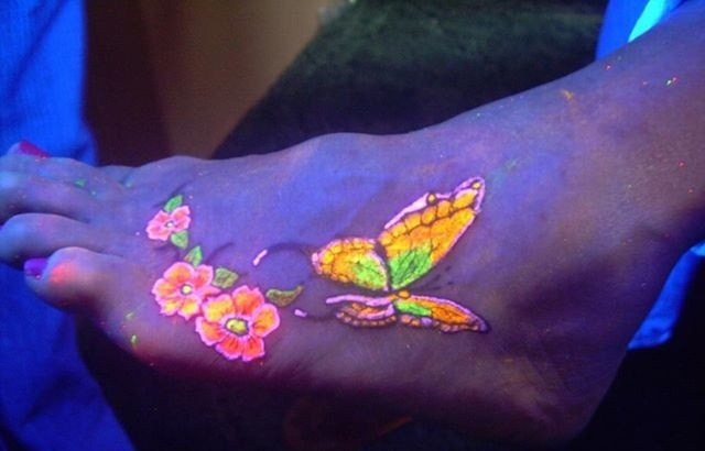 Beautiful butterfly black light tattoo on foot