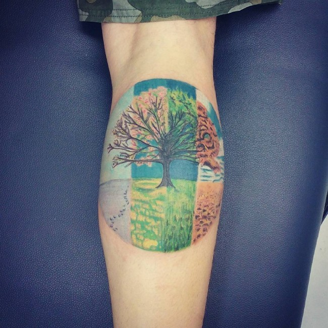 Beautiful circle shaped tattoo on forearm stylized with various seasons tree