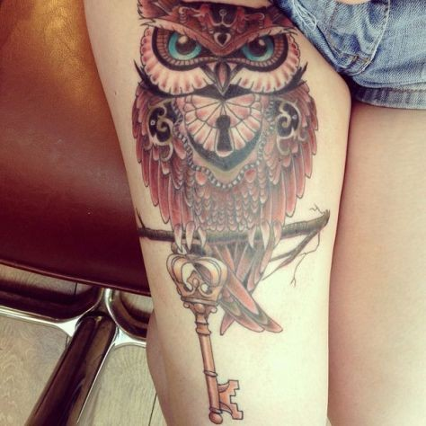 Beautiful colored and detailed big owl shaped lock with antic key tattoo on thigh