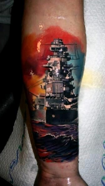 Beautiful colored big navy military ship tattoo on arm