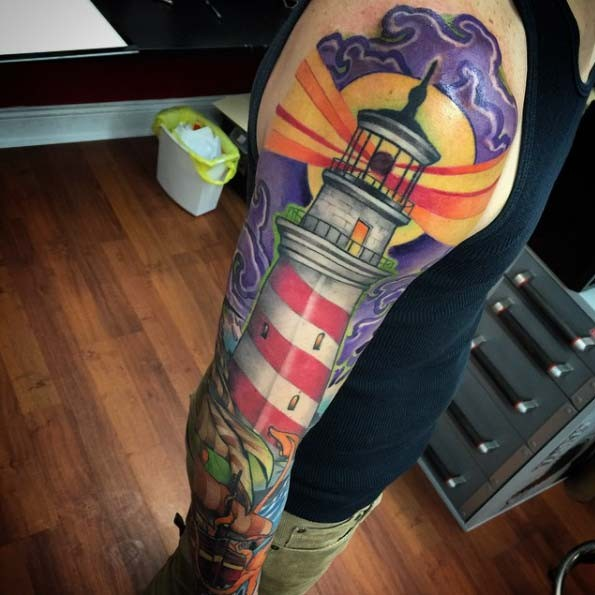 Beautiful colored big shoulder tattoo of lighthouse
