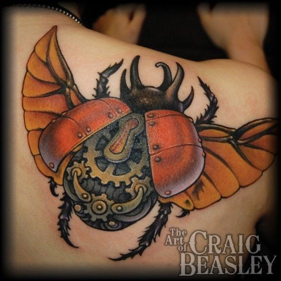 Beautiful colored biomechanical bug  tattoo on shoulder blade by Craig Beasley
