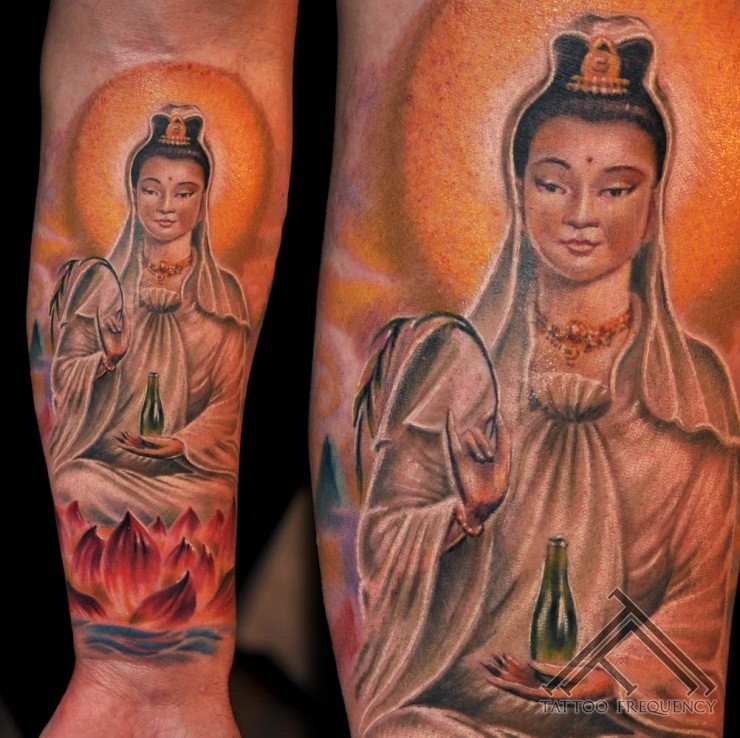 Beautiful colored forearm tattoo of Buddha statue with flowers