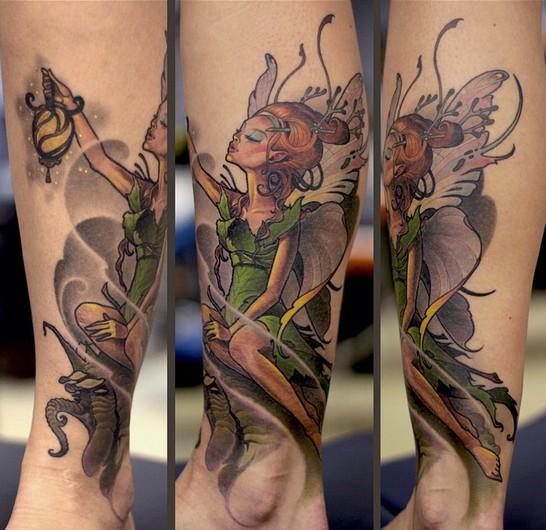 Beautiful colored illustrative style leg tattoo of fantasy Tinkerbell