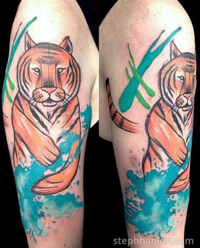 Beautiful colored illustrative style tiger tattoo on shoulder