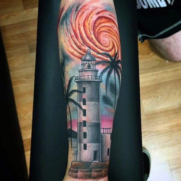 Beautiful colored little lighthouse with palm tree tattoo on hand