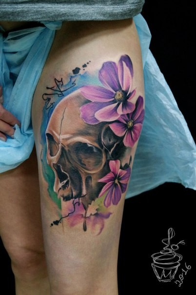 Beautiful colored thigh tattoo of human skull with violet flowers