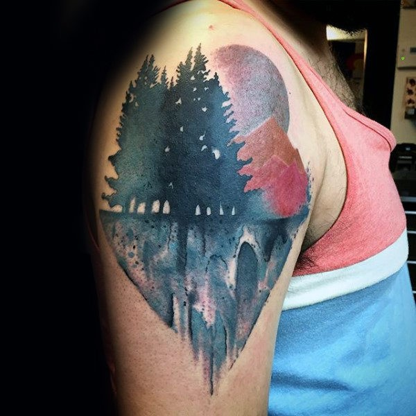 Beautiful colored upper arm tattoo of mountain forest with large moon