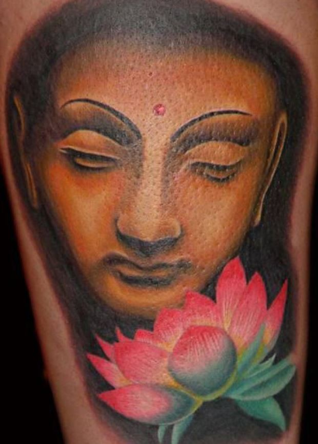 Beautiful colorful buddha with lotus tattoo