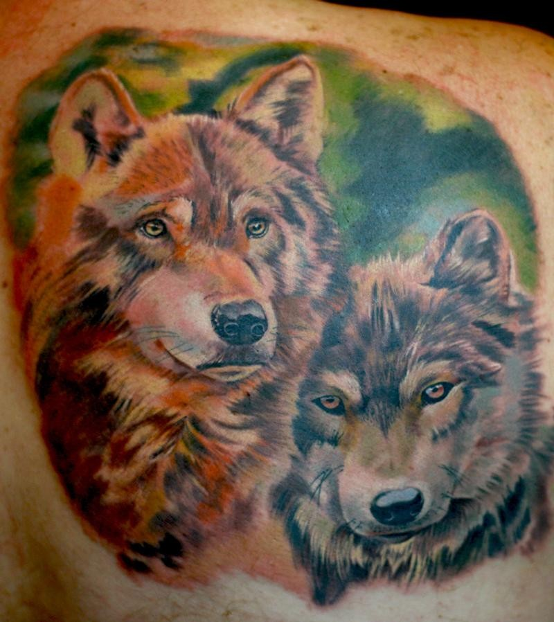 Beautiful colorful wolves tattoo by todo for Tattoos of wolves