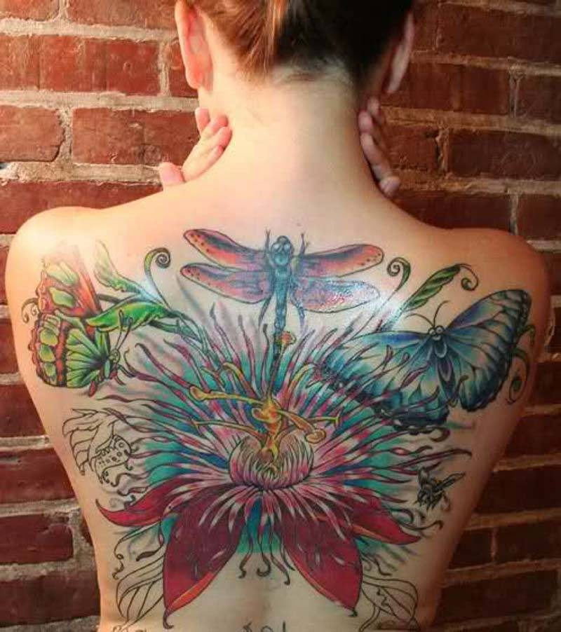 Beautiful coloured dragonfly tattoo on back