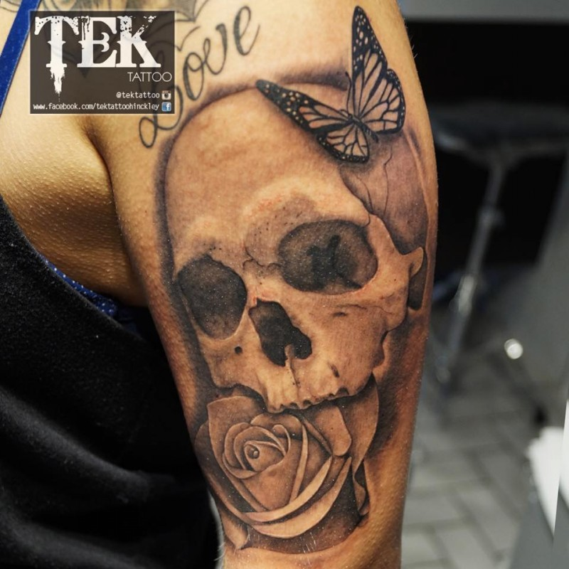 Beautiful combined black and white butterfly on shoulder tattoo with rose and human skull