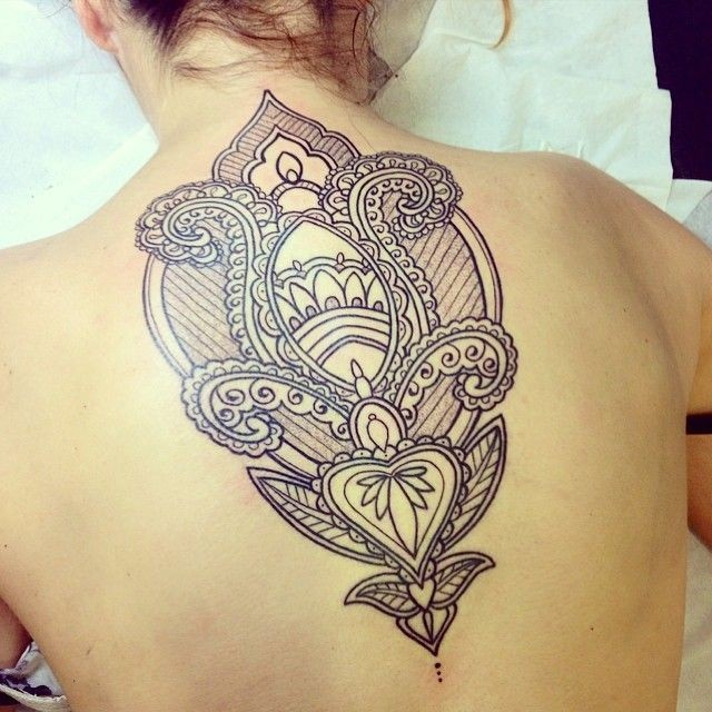 Beautiful designed black and white Hinduism pattern tattoo on upper back