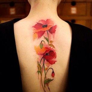 Beautiful elegant red poppies tattoo on back